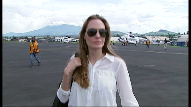 Angelina Jolie announcement on double mastectomy to combat cancer March 2013 Angelina Jolie along at airport in sunglasses Various shots Jolie...