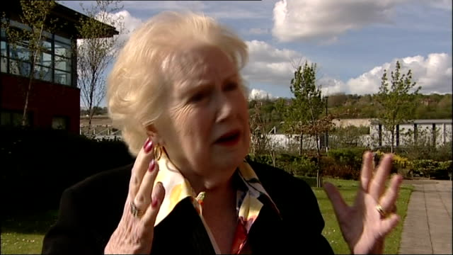 angelina jolie announcement on double mastectomy to combat cancer england denise robertson interview sot - denise robertson stock-videos und b-roll-filmmaterial