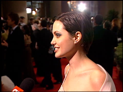 angelina jolie at the 1998 golden globe awards at the beverly hilton in beverly hills, california on january 18, 1998. - golden globe awards stock videos & royalty-free footage