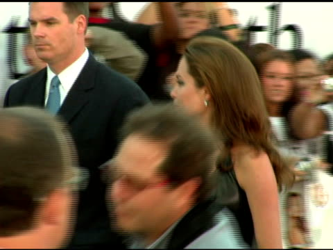 angelina jolie greets fans at the 'mr and mrs smith' world premiere at the mann village theatre in westwood, california on june 7, 2005. - angelina jolie stock videos & royalty-free footage