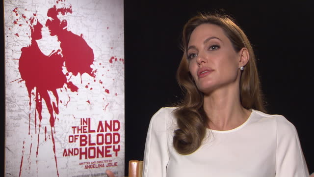 angelina jolie on being a director/writer, writing the story, brad pitt reading the script in the land of blood and honey interviews: 62nd berlinale... - interview raw footage stock videos & royalty-free footage
