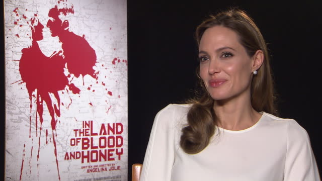 angelina jolie on life in the media spotlight, why her charity work is so important in the land of blood and honey interviews: 62nd berlinale... - interview raw footage stock videos & royalty-free footage