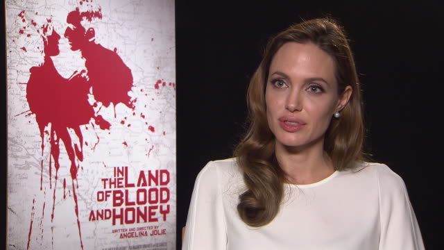 angelina jolie on what audiences can expect, the importance of the film in the land of blood and honey interviews: 62nd berlinale international film... - interview raw footage stock videos & royalty-free footage