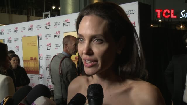 INTERVIEW Angelina Jolie on what it means to premiere her movie at the iconic TCL Chinese Theatre and what it was like working opposite her husband...