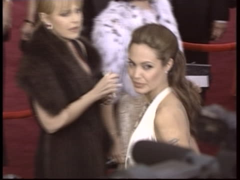 angelina jolie poses for photos on the oscar runway in hollywood, california, at the academy awards in 2004. - oscar party stock videos & royalty-free footage