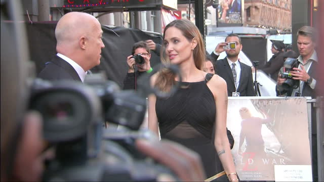 Angelina Jolie signing autographs on red carpet at premiere of film World War Z in Leicester Square Angelina Jolie signing autographs at premiere at...