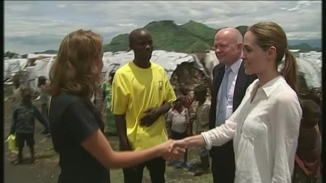 Angelina Jolie to teach at LSE LIB / 250313 North of Goma Nzolo IDP camp Angelina Jolie and William Hague greeting aid workers in camp Angelina Jolie...