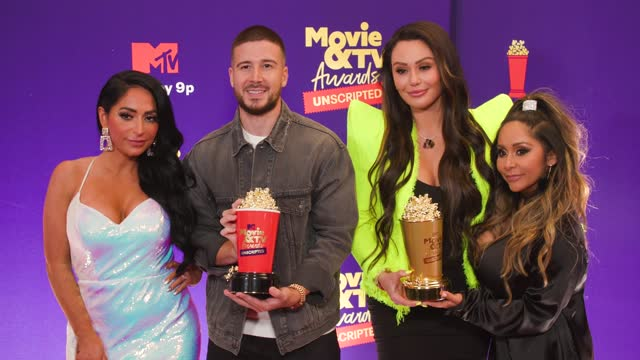 angelina pivarnick, vinny guadagnino, jenni farley and nicole polizzi from jersey shore at the 2021 mtv movie & tv awards: unscripted - backstage on... - mtv stock videos & royalty-free footage