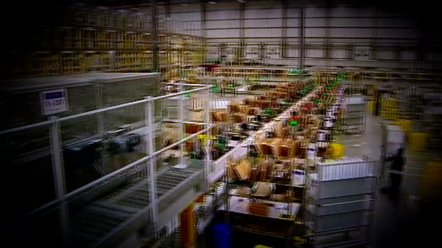 Anger over working conditions at Amazon warehouse in East Midlands R03121205 / 3122012 General views of Amazon warehouse / worker along / yellow...