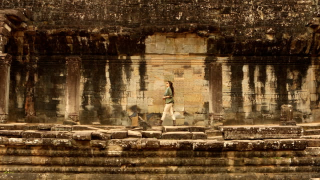 angkor thom exploration - cambodian culture stock videos and b-roll footage
