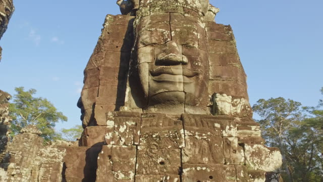 angkor thom temple sculpture angkor wat cambodia 4k video - god stock videos & royalty-free footage