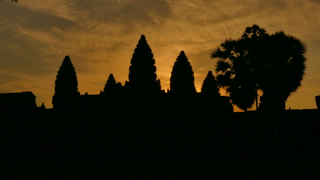 angkor wat temple at sunrise backgrounds - circa 13th century stock videos & royalty-free footage