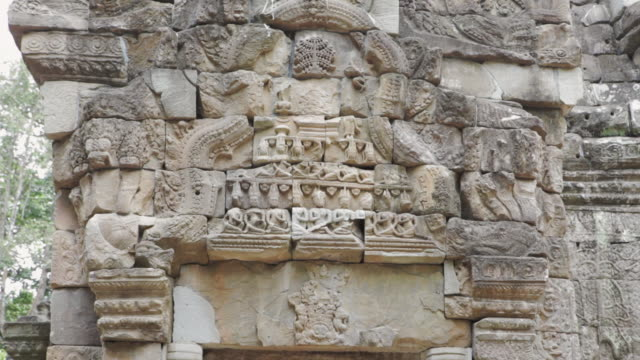 MS, TD Angkor Wat temple doorway with bas-relief carvings in stone / Siem Reap, Cambodia