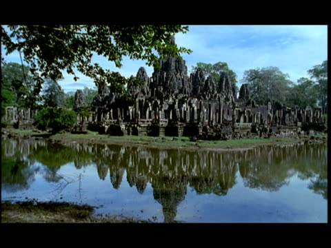 ms, pan, angkor wat temple, moat in foreground, angkor, cambodia - moat stock videos & royalty-free footage