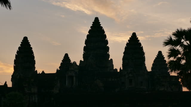 angkor wat temple of cambodia at sunrise silhouette - cambodian culture stock videos and b-roll footage