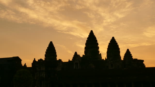 angkor wat temple of cambodia at sunrise silhouette - circa 13th century stock videos & royalty-free footage