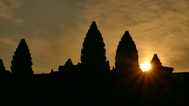angkor wat temple of cambodia at sunrise silhouette - circa 12th century stock videos & royalty-free footage
