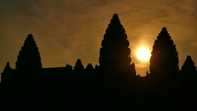 angkor wat temple of cambodia at sunrise silhouette - buddha stock videos & royalty-free footage