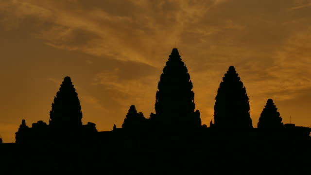 angkor wat temple of cambodia at sunrise silhouette - circa 13th century stock videos and b-roll footage