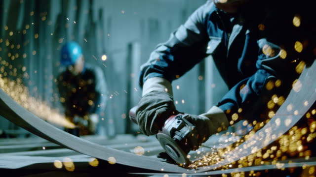 stockvideo's en b-roll-footage met slo mo ld angle grinder causing metal sparks - staal