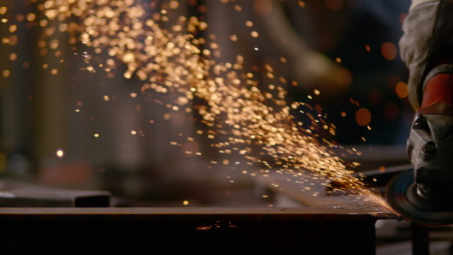 slo mo ds angle grinder causing sparks - stahl stock-videos und b-roll-filmmaterial