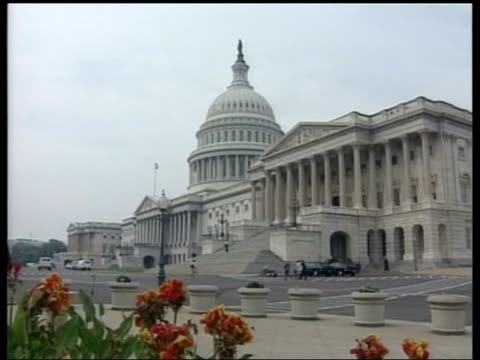 angle gv capitol building zoom in to dome - worldcom stock-videos und b-roll-filmmaterial