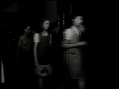 stockvideo's en b-roll-footage met angle ws kallman home for children teenaged orphan children walking down supervised hallway teenage girls folding laundry ironing clothes two teenage... - 1946