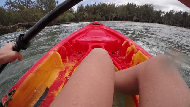 pov angle of ocean kayaker aggressively paddling to catch wave - turtle bay hawaii stock videos & royalty-free footage