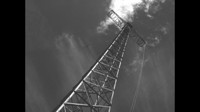 angle shot antenna on ext building / nurses sit in lounge of hospital, watch television - mast stock videos & royalty-free footage