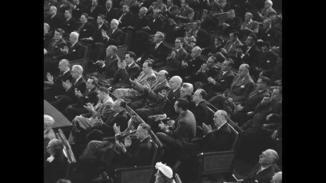 angle shot ext dome of us capitol building / montage members of us congress applaud listen as they attend joint session at which queen juliana of the... - joint session of congress stock videos and b-roll footage
