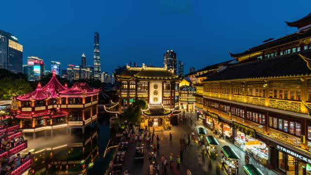 angle view of yu garden and lujiazui financial district, with landmarks as oriental pearl tower, shanghai zigzag bridge, jin mao tower and shanghai tower, shanghai, china - jin mao tower stock videos & royalty-free footage