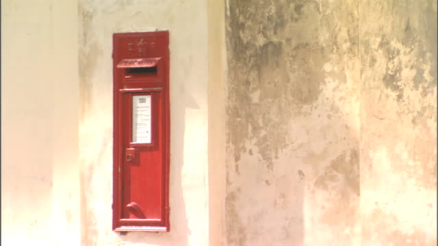 Angled WS 19th Century red British post box on exterior building wall in Misrah San Paul Mail postal post office box British Empire colonialism rule...