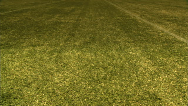 tu angled ws almost half way between ten yard marker lines dolly right passing two yard line marks to just above second line no numbers measurement... - yard measurement stock videos and b-roll footage