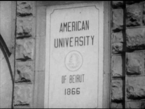 angled american university of beirut w/ cars moving through fg. american university of beirut 1866' building plaque, vs male college students in... - slide rule stock videos & royalty-free footage