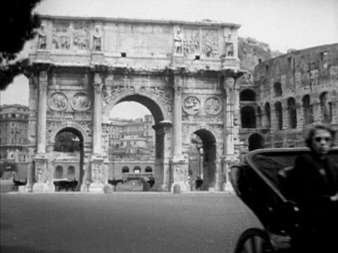 rome italy angled ws arco di costantino westbrook van voorhis walking across piazza toward triumphal arch vs details hadrian medallions friezes... - arch of constantine stock videos and b-roll footage