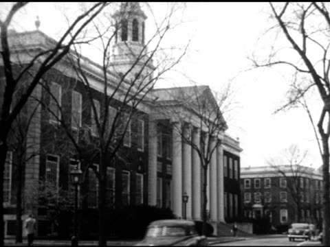 vídeos de stock, filmes e b-roll de angled baker library building & tower of harvard business school, men walking out of library & down steps w/ others walking up steps. mba, masters... - 1951
