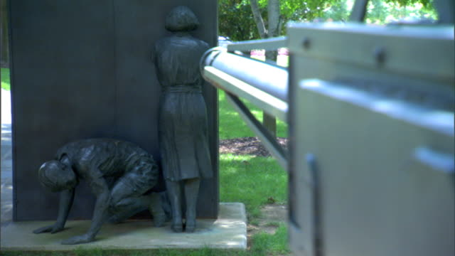 angled ws soft/in focus water hose facing two africanamerican children huddling at wall one on hands knees female standing facing wall out/in focus... - hose stock videos & royalty-free footage