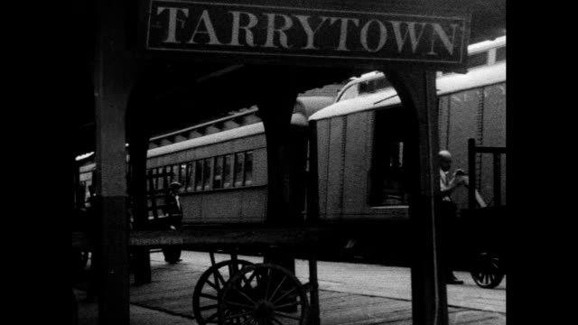 HD Angled WS Commuter railroad train car pulling into Tarrytown station GALLERY REENACTMENT WS Small sign w/ arrow for Westchester Institute of Fine...
