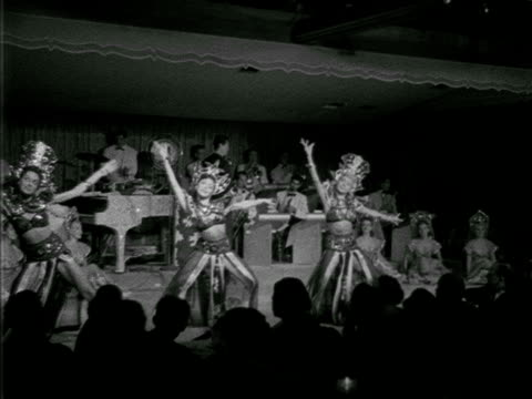 angled ws dancers on stage dressed in traditional thailand influenced dancer costumes thai headdresses modern dancing live band accompaniment playing... - 1952 stock videos and b-roll footage
