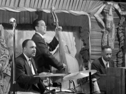 Angled WS Dixieland Jazz band string amp percussion drums bass piano players SOT playing amp singing 'When the Saints Come Marching In' trumpet...