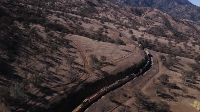 Angled Drone Shot of Freight Train in Tehachapi Loop