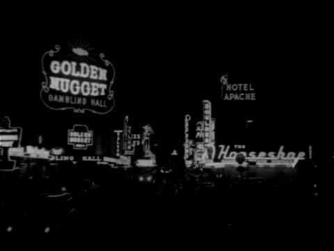 night angled ws fremont street w/ neon signs 'golden nugget' 'the horseshoe' 'hotel apache' vegas vic in distance tu vegas vic waving amp pointing... - horseshoe stock videos and b-roll footage