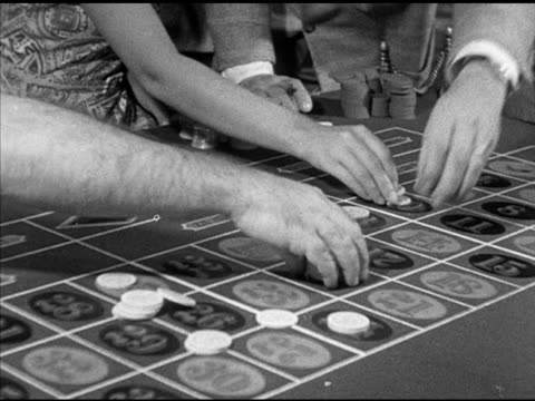 angled ms hands placing chips bets on numbers on table angled ws people placing bets on roulette table w/ stacks of chips wheel fg td ms roulette... - gambling stock videos & royalty-free footage