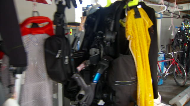 hd angled ws hanging horizontal pole w/ scuba diving dive suits gloves weight harness/bouyancy compensator other dive equipment hanging drying in... - drying rack stock videos and b-roll footage