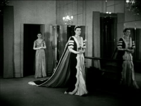 angled ws hartnell building in salon ws female model modeling court robe of marchioness w/ eighteen foot train holding coronet in hands ms coronet... - marchioness stock videos and b-roll footage