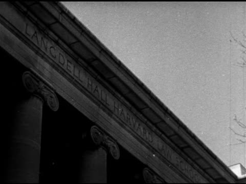schools angled ws law school building tu carved letters above columns 'langdell hall harvard law scho' ha ws medical school building la tu people... - 1951 stock-videos und b-roll-filmmaterial