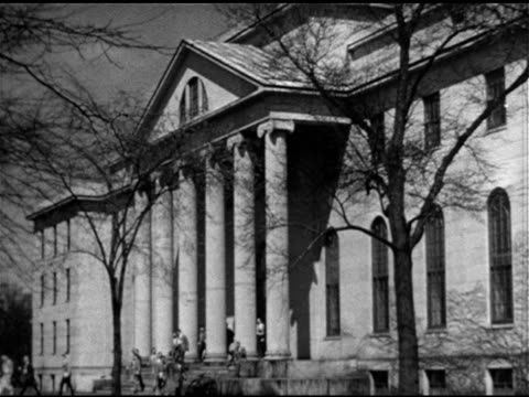 schools angled ws littauer center of public administration building ws lettering above columns people walking behind columns down steps [now part of... - 1951 stock-videos und b-roll-filmmaterial