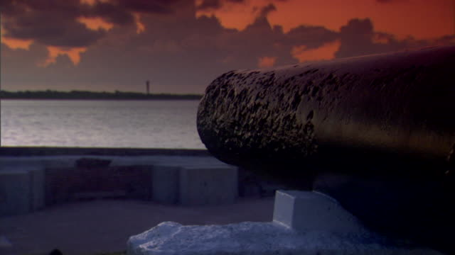 Angled MS Next to Cannon facing Charleston Harbor w/ dark cloud cover American Civil War Federal fort Confederate Union South North slavery...