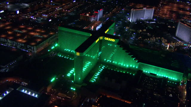hd night aerial *angled ws north side of mgm grand hotel casino moving toward td over slow rotation to ws moving away from mgm - mgm grand las vegas stock videos & royalty-free footage