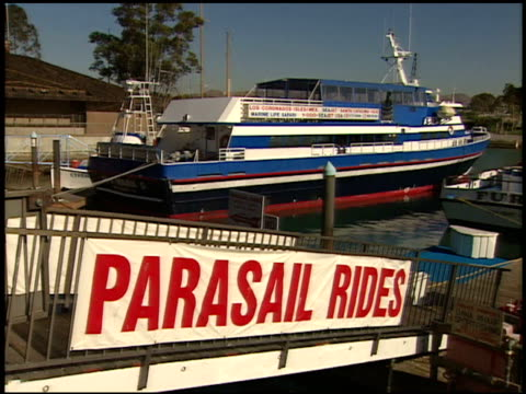 angled ws parasail rides sign on side of boat boarding ramp docked commercial vessel like small ferry bg - boat ramp stock videos & royalty-free footage
